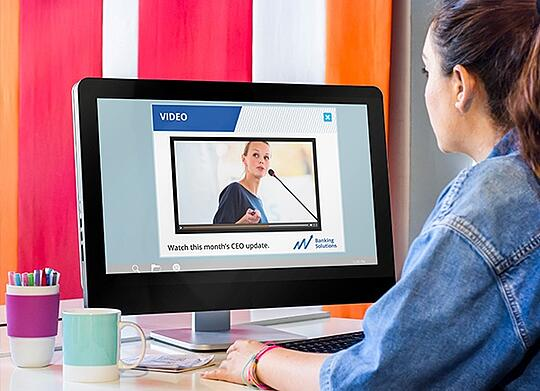 Woman watching video alert from ceo