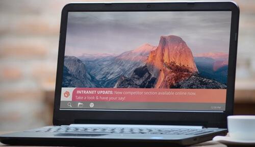 laptop displaying intranet update ticker