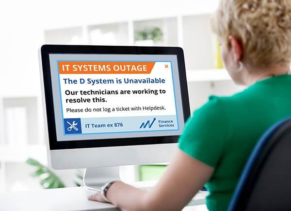 Woman viewing network outage alert message on desktop