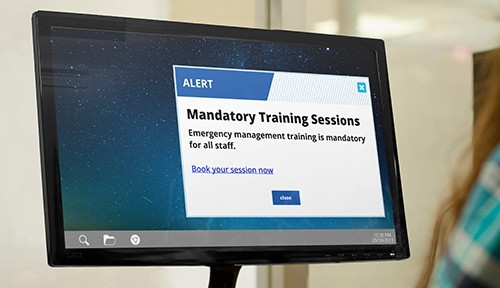 mandatory training alert on laptop